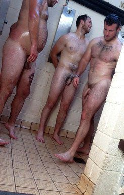 Hung rugby players in the gym showers