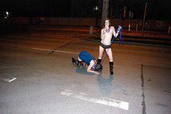 Submissive slave girl on leash, night walk