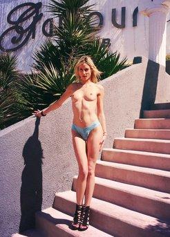 Long-legged girl posing on the steps
