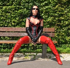 sexy ladies dressed in leather and red boots