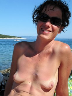 Wife sunbathing topless and doing blowjob...