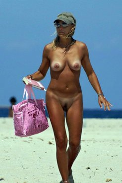 Older female nudists on vacation candid...