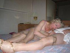 British MILF sucking husband's cock